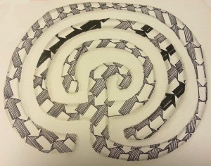 Large filled labyrinth with white path left intact
