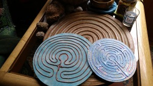 Two handmade Finger Labyrinths sit on top of a crafted ceramic finger labyrinth