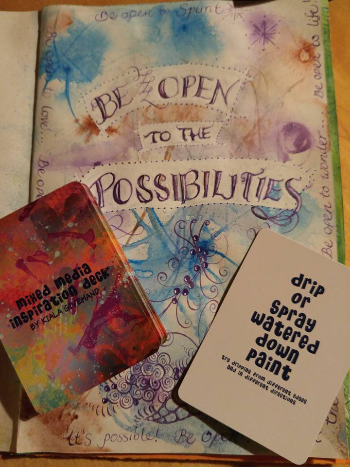 Open to Possibilities journal page with dripped and sprayed acrylic inks by Sadelle Wiltshire, with Kiala Givehand's Mixed Media Inspiration Deck